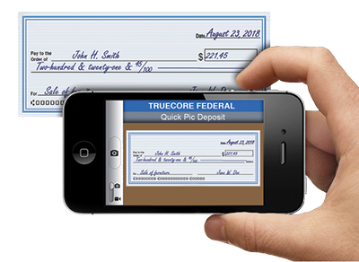 Image of a smartphone taking a photo of a check.